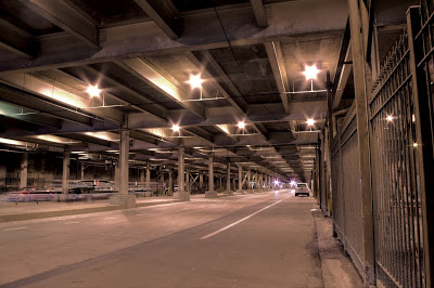 This photo is before the 2 year multi-million dollar renovation to Lower Wacker. In the crevices, where the bridge met the concrete, housed many of Chicago's homeless population. I remember very vividly as a child being amazed by the make shift shelters of sheets and personal possessions set up right up under Michigan Avenue where people were easily spending tens of thousands of dollars on one nights entertainment. Photo courtesy of www.autonueroticfixation.com.